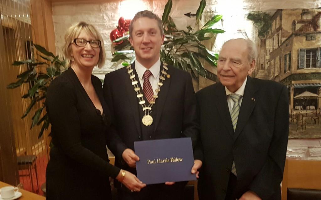 President Niall Reck, being Presented with the Paul Harris Award Bu Jurgen Sassmanhaussen and Vice President Maura Bell